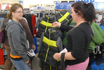 Felicia Hamilton, left, Milton, and Victoria Hause, New Columbia, look at a selection of kids coats for sale at the grand opening of Peebles in Lewisburg on Thursday morning.
