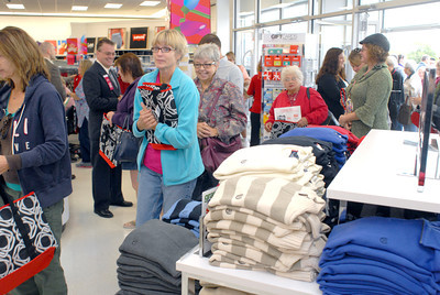 Crowds of people pour into the new Peebles store for the first time on Thursday morning.