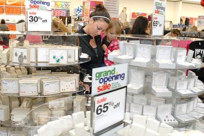 Alyssa Lewis and Ava Beaver, 3, Lewisburg, check out some sales at the grand opening of Peebles in Lewisburg on Thursday morning.