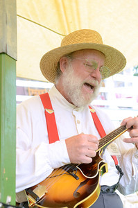 Larry Mitchell of Mifflinburg sings a tune at the Dale Engle Walker House in Lewisburg for the Rural Heritage Days on Wednesday.