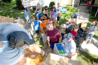 School supplies that were donated for tornado victims in Oklahoma were loaded onto a truck Friday morning outside the Mifflinburg Library by a group of volunteers.