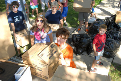 Volunteers Derek Stahl, left, Lauren Stahl, Janice Walter, Kelly Walter, and Brandon Grove, help load up boxes and bags full of school supplies onto a truck Friday morning outside the Mifflinburg Library to be taken to Oklahoma for tornado victims.