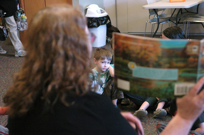 Joel Landon, 5, listens to a story at the Union County Library on Friday.