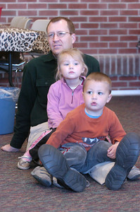 John McIlwaine and his children Audra, 4, and Olin, 2, listen to a story on Friday at the Union County Library.