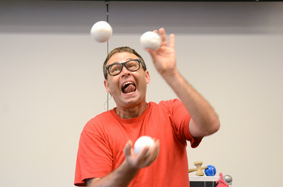 Paul Miller performs his Science of Awesome program at the Union County Library on Friday afternoon.