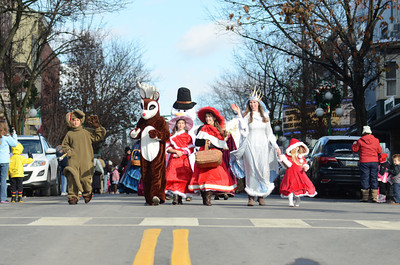 Parade participants make their way down Market Street in Lewisburg during the Victorian Parade on Saturday.