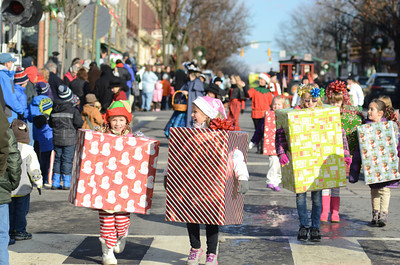Janelle Linder, 7, and Wrenn Underkoffler, 7, were all wrapped up for the Victorian Parade in Lewisburg on Saturday on Market Street.