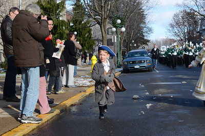 Andrew Hoffman, 5, races down Market Street during Saturday's Victorian Parade in Lewisburg.