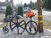 """Perhaps the iron Penny Farthing is an advertisement for the RV and Boat place.  """"Get an RV...it's faster than this thing!""""  """"Get a boat...it will float, unlike this thing!"""""""