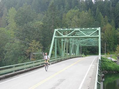 JC and back-roads bridge.
