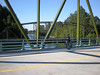 "2008: Great shot of Miles showing both new bridge and Old Bridge. Compare to shot linked below of Jeff Sloan in roughly the same position on the Old Bridge--making the final unicycle crossing--just a few weeks earlier. <a href=""http://www.hayope.smugmug.com/gallery/4961928_PUFTd#296974533_dFEQR-L-LB"">http://www.hayope.smugmug.com/gallery/4961928_PUFTd#296974533_dFEQR-L-LB</a>"