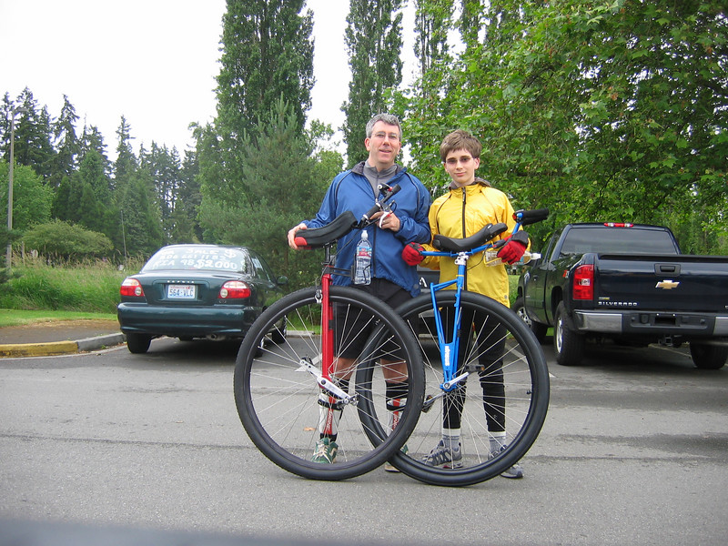 Me and Miles in the Marymoor Park-inglot, preparing for our Father's Day 2007 ride.  If there's a better thing to do than go unicycling with your kid on Father's Day, I don't know what it is.