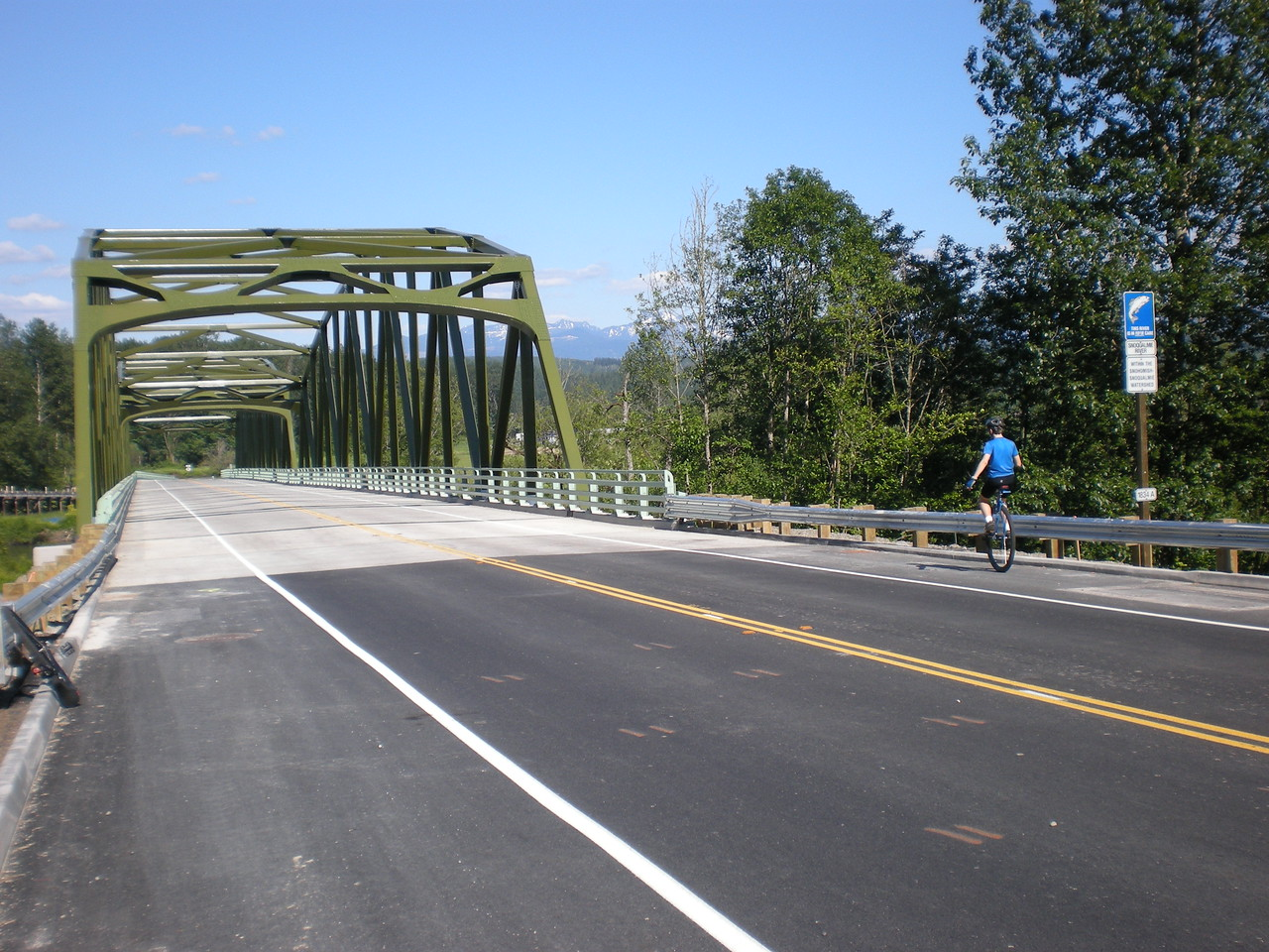 2008:  Miles, making the inaugural Unicycle Crossing of the brand new bridge over the Snoqualmie River outside Carnation. Jeff S and I tried to christen this bridge a few weeks earlier when it was in place but still closed. It was in the midst of being painted, and the workers wouldn't let us cross. See the Jeff RTL Qualifying Ride album for pics on that.  Anyway, I was glad that Miles was able to make First Crossing. Special add to the day.