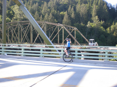 2008:  Miles on the new Snoqualmie River bridge, with the Old Bridge in the background. Soon the Old Bridge (1923) will be gone. It was cool old bridge, and when riding across it you could see down through the cracks in the road bed to the river below.