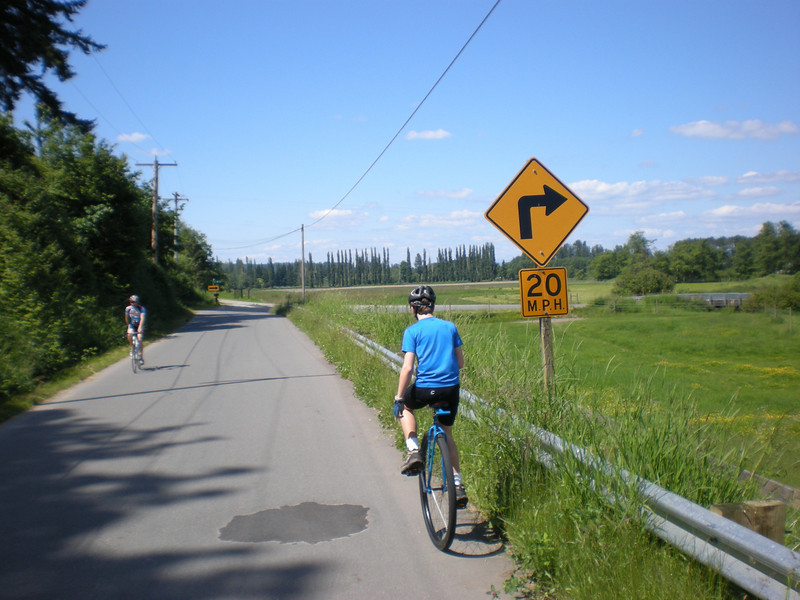 2008:  Miles, slowing it down so he'll hit the corner at the recommended speed. This rural farm road along the Snoqualmie River is one of my favorite training rides in the summer, and it's always fun to share it with Miles.