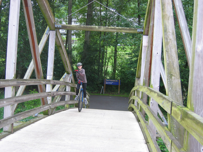 2007:  Miles climbing up the steep arch bridge at Bothell Landing.   No problem!