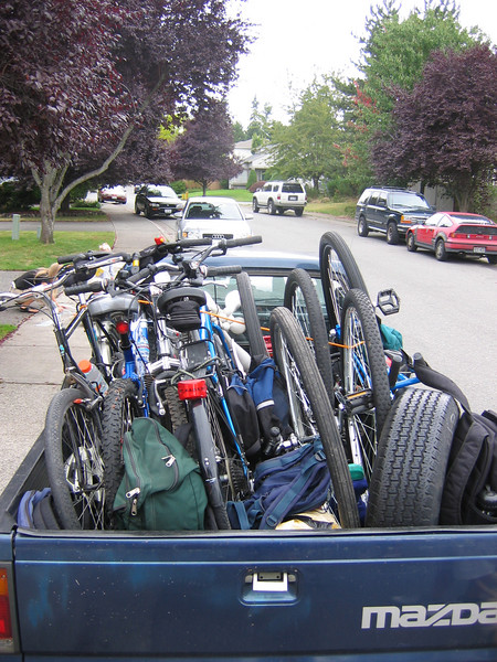 It took two vehicles to carry all the unis and bikes, and three vehicles to carry all the riders. Here Harper has done his usual efficient job maximizing unis and bikes into the back of his truck.