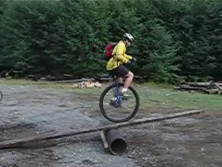 "Movie:  Miles doing his first-ever ""Coker trials"", taking the big wheel over a teeter-totter he constructed.  No problem!"
