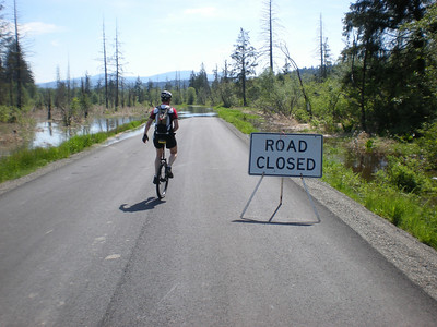 "Our second ""Road Closed"" sign of the day.  This is along the Snoqualmie River Road, which runs roughly parallel with the river at valley floor level.  Note the river has decided to take a shortcut across the road just ahead.  This was taken at about 3pm Saturday. I drove this road at 6:30pm Friday, and the road was clear."