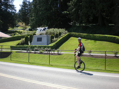 Jeff, riding by the Historic Cow statue in front of the historic Carnation Farm. This was research and breeding facility that helped support much of the evaporated and condensed milk production in America during the middle part of the last century. Note that the Historic Cow really needs to be milked.