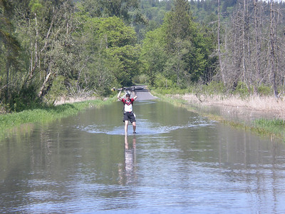 We rode a lot of the way through, but once the water reached up to his expensive Schlumpf hub, Jeff wisely dismounted and started portage. Flooded roads turn out to be one of the few situations where the ungeared 36 has an advantage over the geared 29.