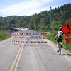 The start of trouble. At 30 miles into our ride, we found the road closed because they were busy building the on and off ramps to a brand new bridge (visible above the left-most barrier, and destroying the old road that leads to the VERY old bridge (much smaller, and visible directly above the No Bicycles sign). We were hoping to be the first unicyclists to ride across the new bridge, but there were workers painting it, and they sharply turned us back. But the road to the old bridge was flooded out by the very high river, so we had to bypass it by hanging over the side of the new bridge, dropping to a dry spot below, then handing down our unicycles. This became the Point of No Return, as there was no way to climb back up the route we had just taken.