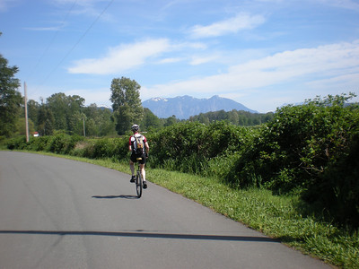 Back on dry land once again...   Jeff on a traffic-free farm road, with big 'ol Mount Si in the background.