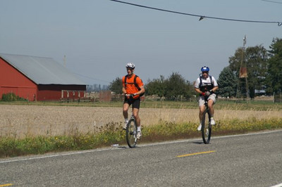 "Bruce and Tom and Skagit County farm.  I think Bruce was about to embark on one of his ""crank it up to 18 mph and catch the peleton"" runs."