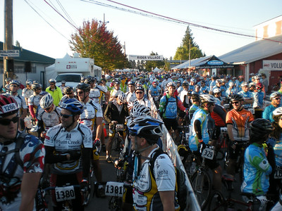 Cyclists lined up all the way back through rider village, waiting for the staged start to begin.
