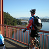 Bruce riding over Rainbow Bridge on the way out of La Conner, WA.