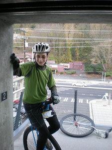 Miles, preparing to ride his unicycle into the elevator of the famous (and costly) Helix Bridge.