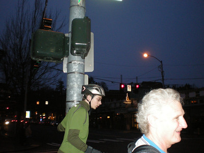 "We had so much fun goofing around that we lost track of time, finished our ride in the dark.  Here the ""Age Rider"" hangs out with the ""Age Shower"", waiting for the Walk light so they can cross."