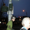"""We had so much fun goofing around that we lost track of time, finished our ride in the dark.  Here the """"Age Rider"""" hangs out with the """"Age Shower"""", waiting for the Walk light so they can cross."""