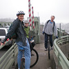 Travis, Miles, and Harper on Ballard Bridge, with Fisherman's Terminal in background.