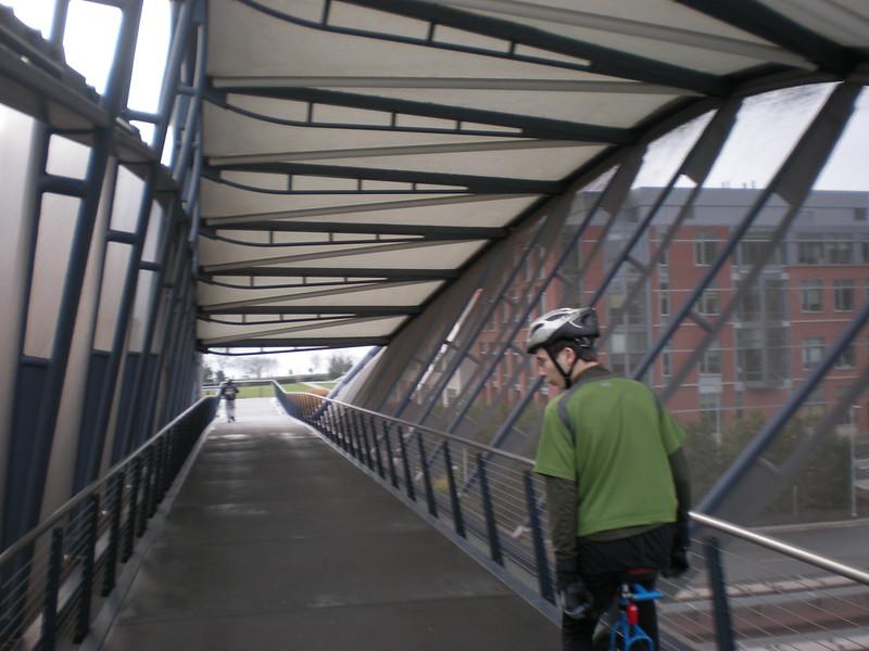 Miles crossing back across the Helix Bridge.