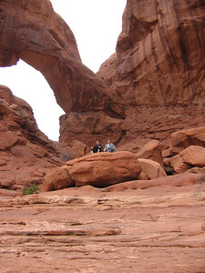 Irene and me on a rock under Double Arch, Arches National Park.