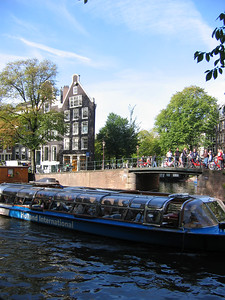 Canal, tour boat, and funky old house which appeared visually to be two-dimensional.