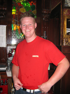 The bartender. Once he realized I was taking a picture of all things Amstel, he needed to be a part of it with his red Amstel shirt (complete with Amstel spilled on it) and red Amstel face.