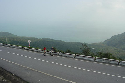 This is one of my favorite photos from the tour. Andy (red) and me about half-way up the Hai Van Pass climb, which started at sea level. We were just approaching a right-hand hairpin-switchback, which is why we're on the wrong side of the road. The insides of the switchbacks were really steep, so if traffic allowed, we crossed over to the outside to make the turns.  This photo was taken from the road above, just after the switchback, and I seem to remember Nathan H, the photographer, giving us a hard time for being wussies and crossing to the outside to make the turn.