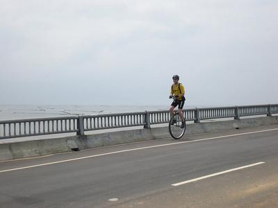 Jason (USA) tooling across the Bridge to Nowhere.
