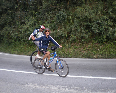 Hoah, one of our awesome local guides, slows down to wave, giving Sid the opportunity to power by on the outside.