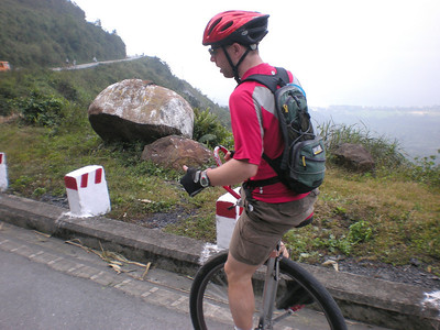Andy Cotter (USA), a veteran of many unicycle tours. We were just starting down the long drop from the top of Hai Van Pass back to sea level. We both agreed it was important to not get going to fast on the descent. The next riding day, Nic would learn to agree with us too...the hard way.