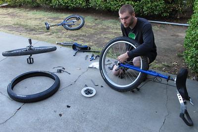 "Eric ""Saskatchewanian"" Pulvermacher, putting together his disk braked 26"" in a 36"" frame"