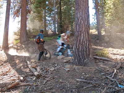 A downhill bike blazes past Eric