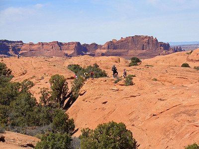 Slickrock trail, with Arches National Park in the background (those darker cliffs).