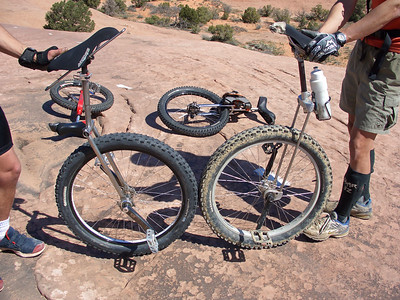 Unique creations by Creative Geckos. The one on the right uses titanium rods for a suspension effect. The bent frames are to keep the fork crown away from the rider's knees.