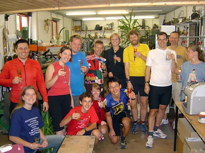 [KL] Visiting master unicycle builder Florian Schlumpf in Vilters, Switzerland.  Florian is second from the right, between John and Connie.