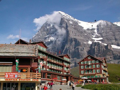"""The famous town of Kleine Scheidegg, on the way to """"The Top of Europe"""" by train. The Eiger north face looks menacing behind."""