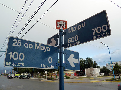 The street signs in Ushuaia have latitude and longitude, S=latitude Sur (south), O=longitude Oeste (west) 2011-01-13 15:25:14 by Nathan Hoover