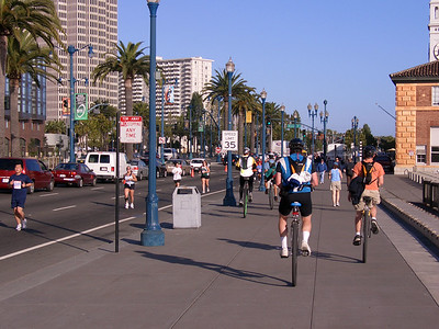Heading up the Embarcadero, while runners head down. The run was a fun-raiser for the families of 9/11 victims.